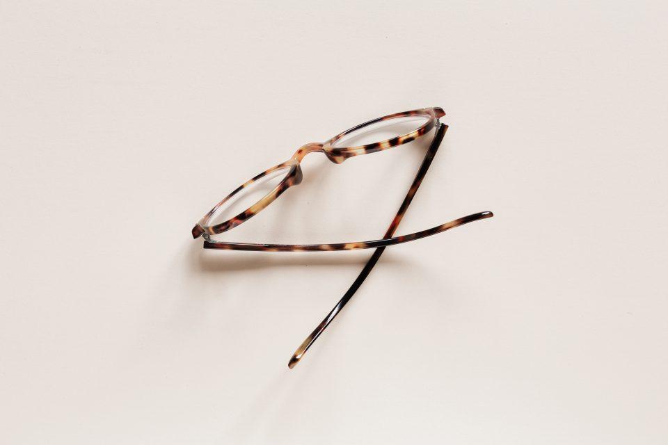 stylish-eyeglasses-placed-on-beige-surface-4226877