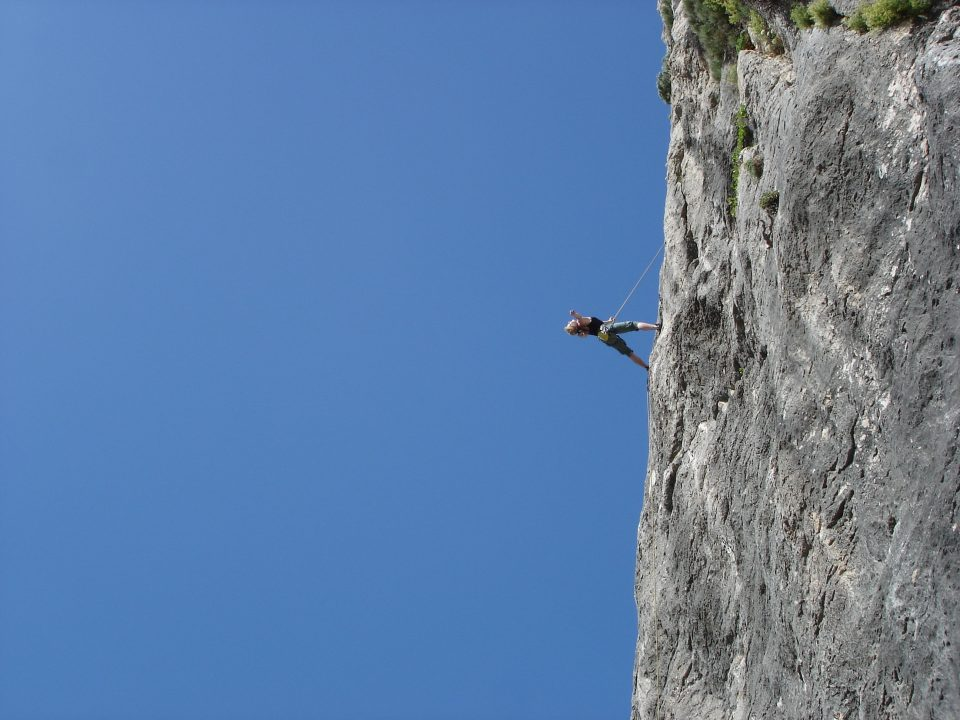 man-standing-on-rock-against-clear-blue-sky-256894